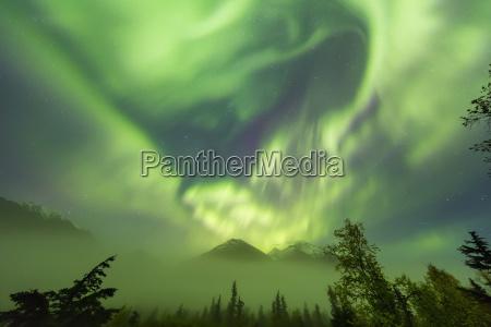 bright green aurora borealis dances over