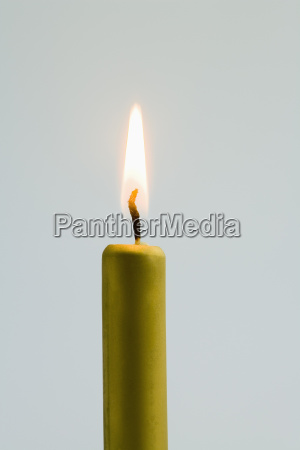closeup of golden lit christmas candle