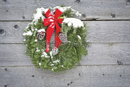 holiday wreath hanging on the side