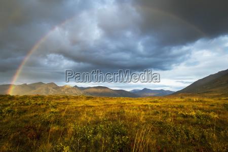 a rainbow in the sky over