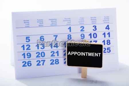 miniature appointment placard in front of