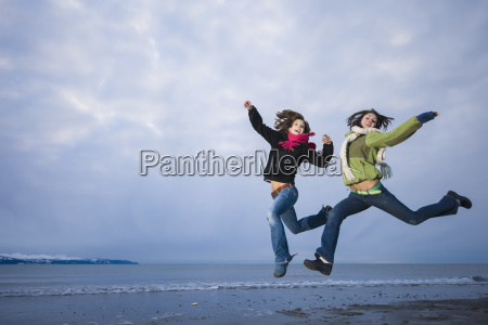 young women playing and jumping on