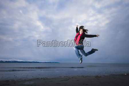 young woman playing and jumping on