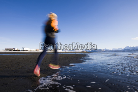 a young woman running along the
