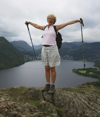 a woman stands with her trekking