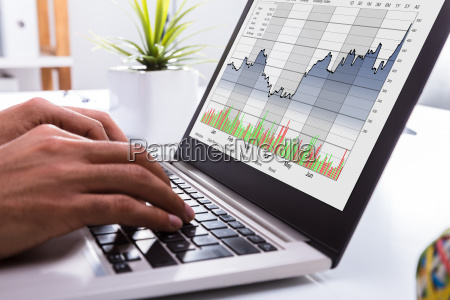 stock market broker analyzing graph on