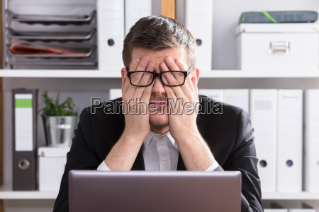 close up of a tired businessman