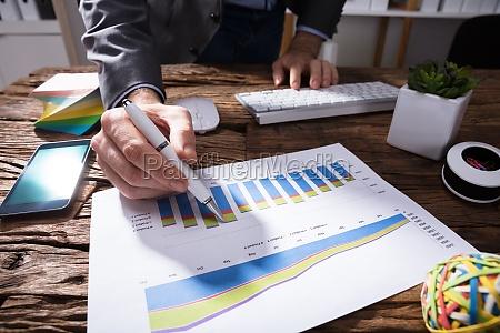 businessperson analyzing financial graph