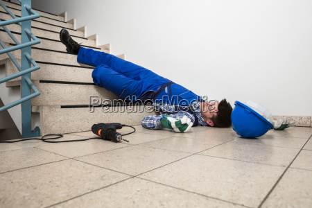 handyman lying on staircase