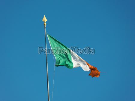 irish flag of ireland over blue