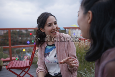 happy woman talking to female friend