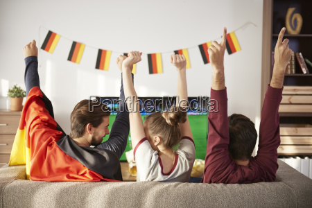 german football fans watching tv and