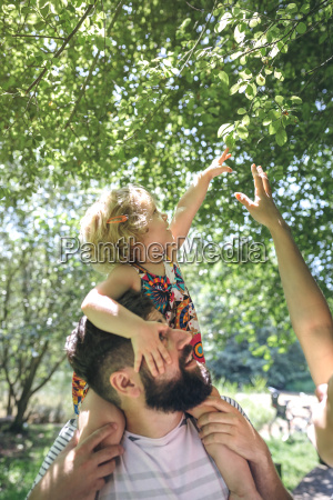 little girl on her fathers shoulders
