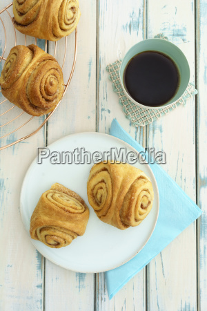 home baked franzbroetchen and cup of