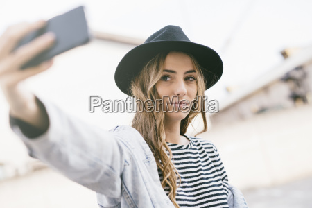 portrait of fashionable young woman wearing
