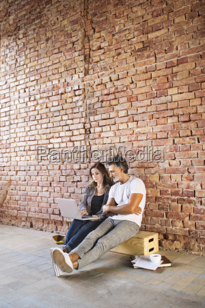 businessman and woman sitting in a