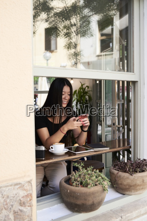 smiling asian woman chatting with her