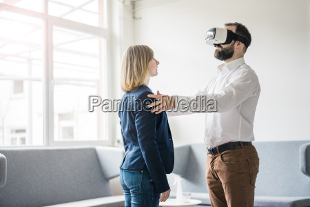 businessman with vr glasses in office