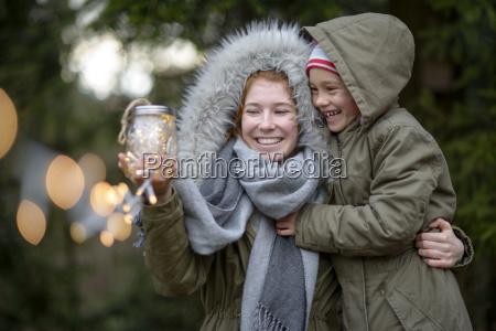 happy teenage girl and her little