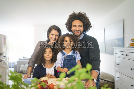 happy family baking pizza at home