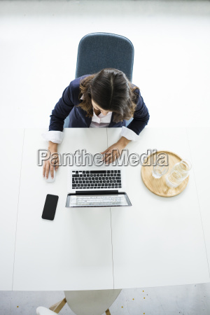 businesswoman sitting at desk in the