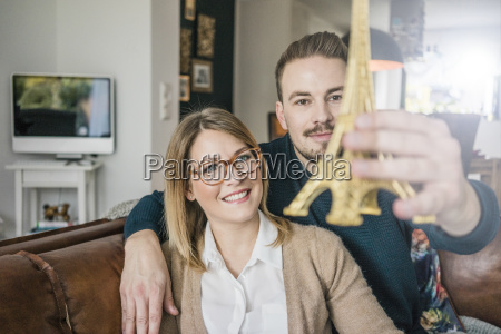 smiling couple sitting on couch at