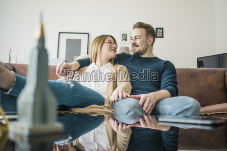 couple sitting on couch at home