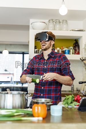 happy young man wearing vr glasses