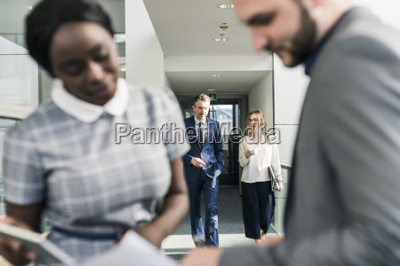 business people talking on office floor