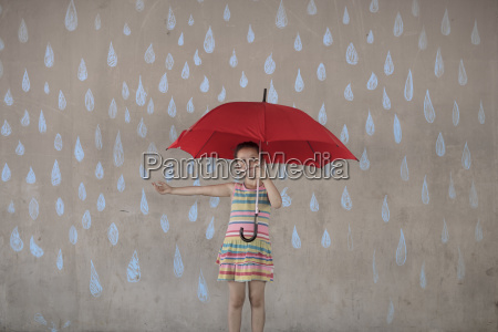 girl holding a red umbrella standing