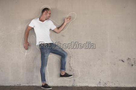 man pretending to be dead standing
