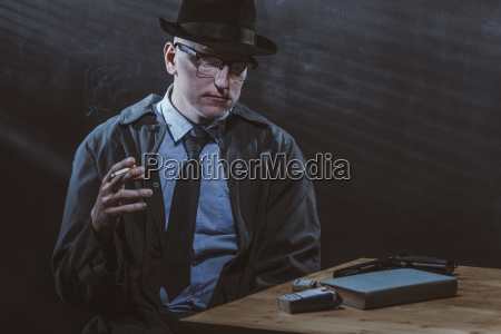 young man sitting at table while