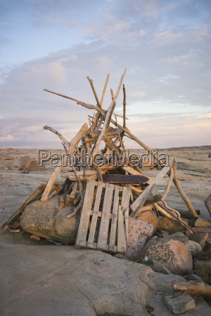 heap of driftwood and rocks on
