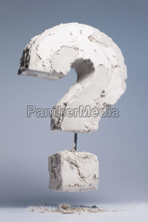 question mark made of stone material