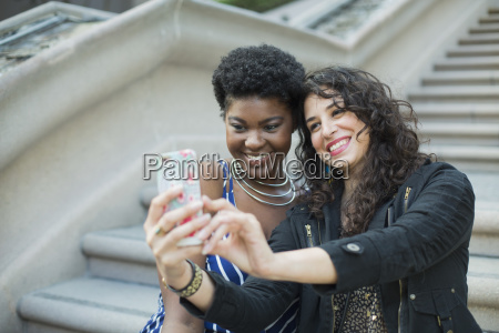 happy woman taking selfie with young