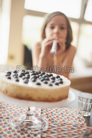 cake on stand at table with
