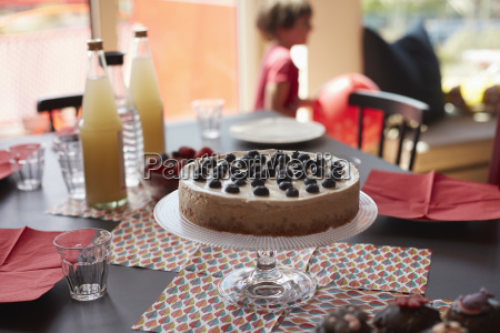 cake on stand over place mats