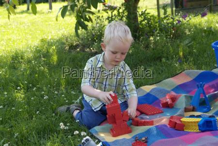 boy plays with lego