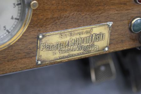 brass sign on a vintage car