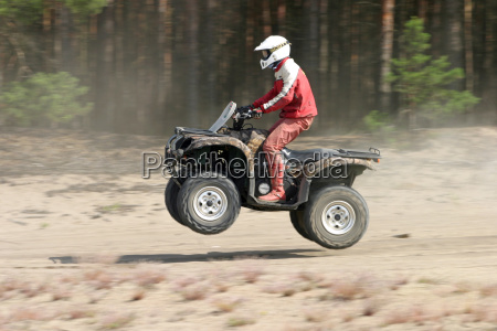 quad in the jump at rallye