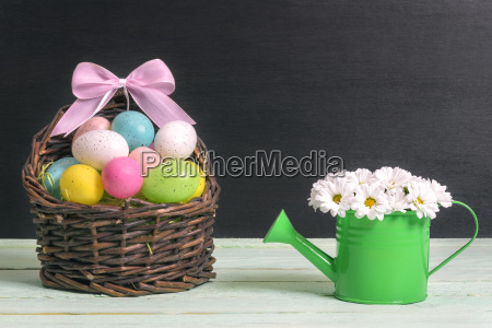 basket with easter eggs and a