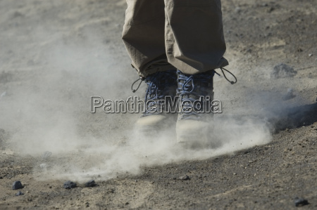dusting steps with trekking shoes in