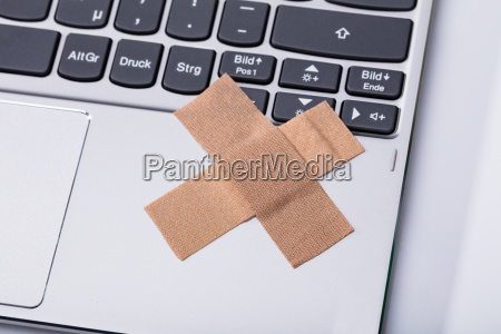 laptop keypad with cross band aid