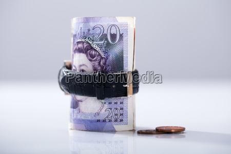 rolled up twenty pounds currency note