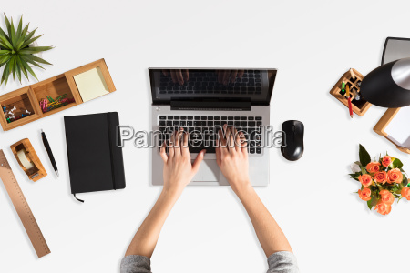 businessperson using laptop with blank screen