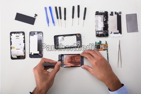 technician fixing damaged screen on mobile