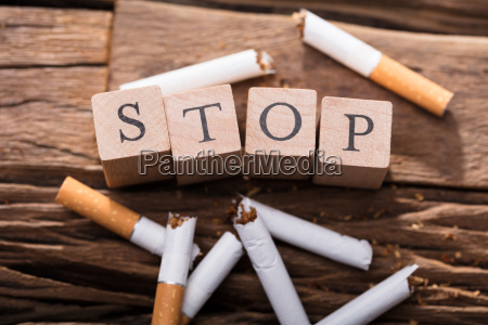 cigarette and wooden blocks showing stop