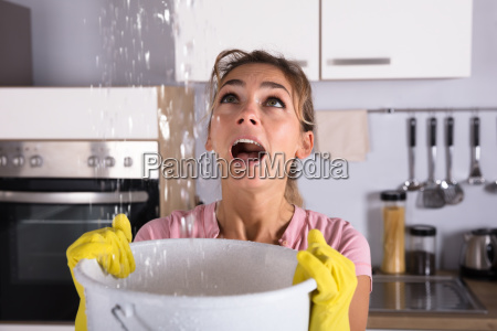 woman holding a bucket while water