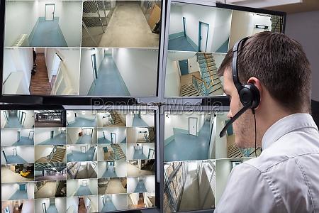 operator looking at multiple camera footage