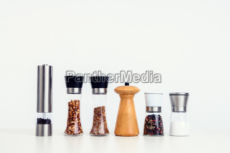 different spice mills with saltpepper and